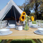 Outside Bell Tent with dining table