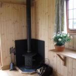 Fireplace inside Shepherd's Hut